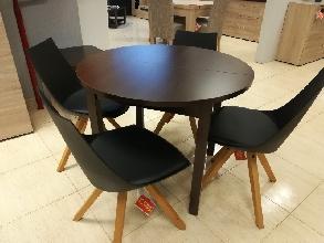 Conjunto de mesa redonda y 4 sillas negras pata nórdica.
